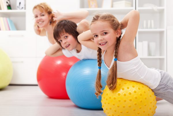 children on exercise balls