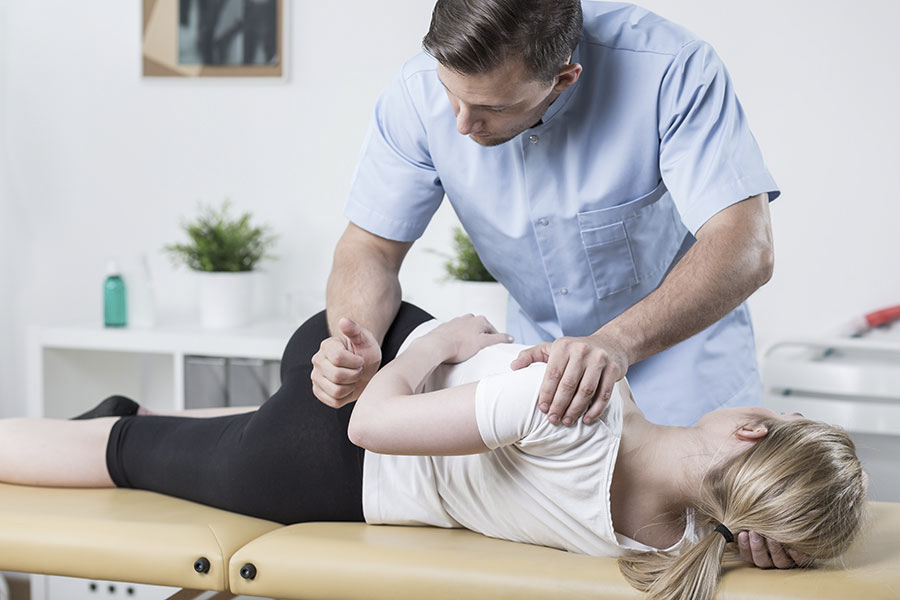 Woman on physiotherapy table